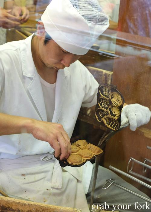 Freshly made taiyaki fish cakes filled with red bean paste at Nakamise, Sensoji Temple, Asakusa, Tokyo