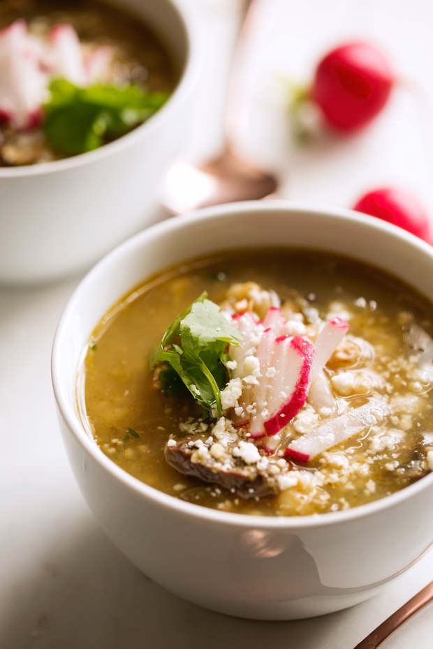 Hearty Chicken Posole Verde - loaded with shredded chicken and sliced mushrooms, this stew is super filling and so comforting! #chickenstew #chickenposole #posoleverde | Littlespicejar.com@littlespicejar