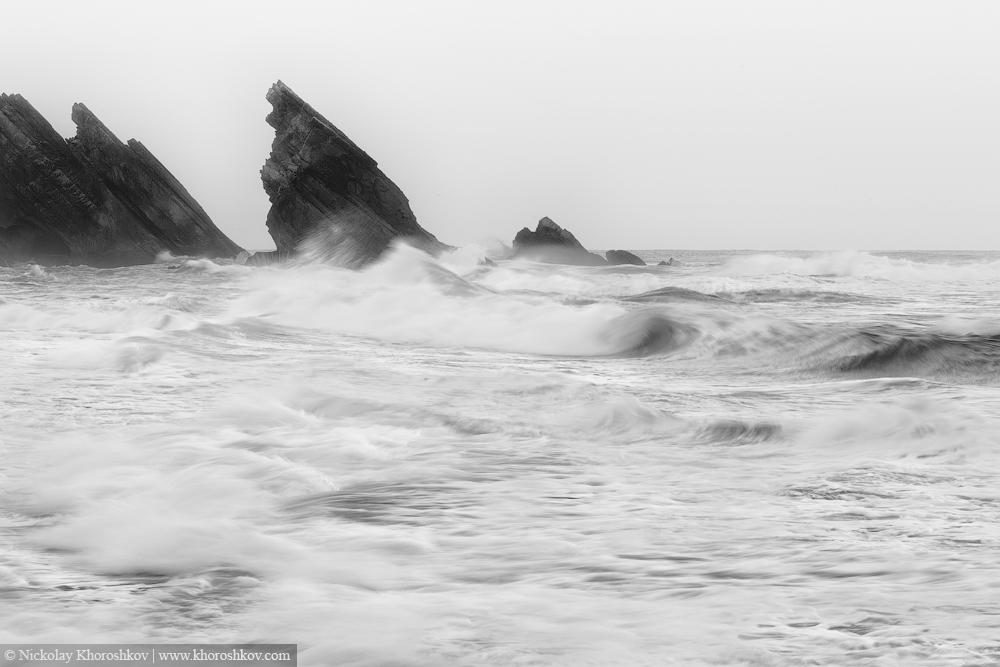 Black and white photo of Atlantic ocean rocky coastline