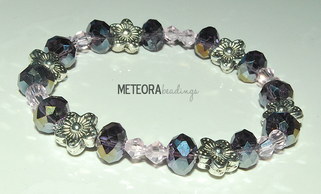 Bracelet - dark purple and light pink beads, with silver flower seperators