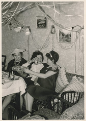 Women eating and drinking at a party