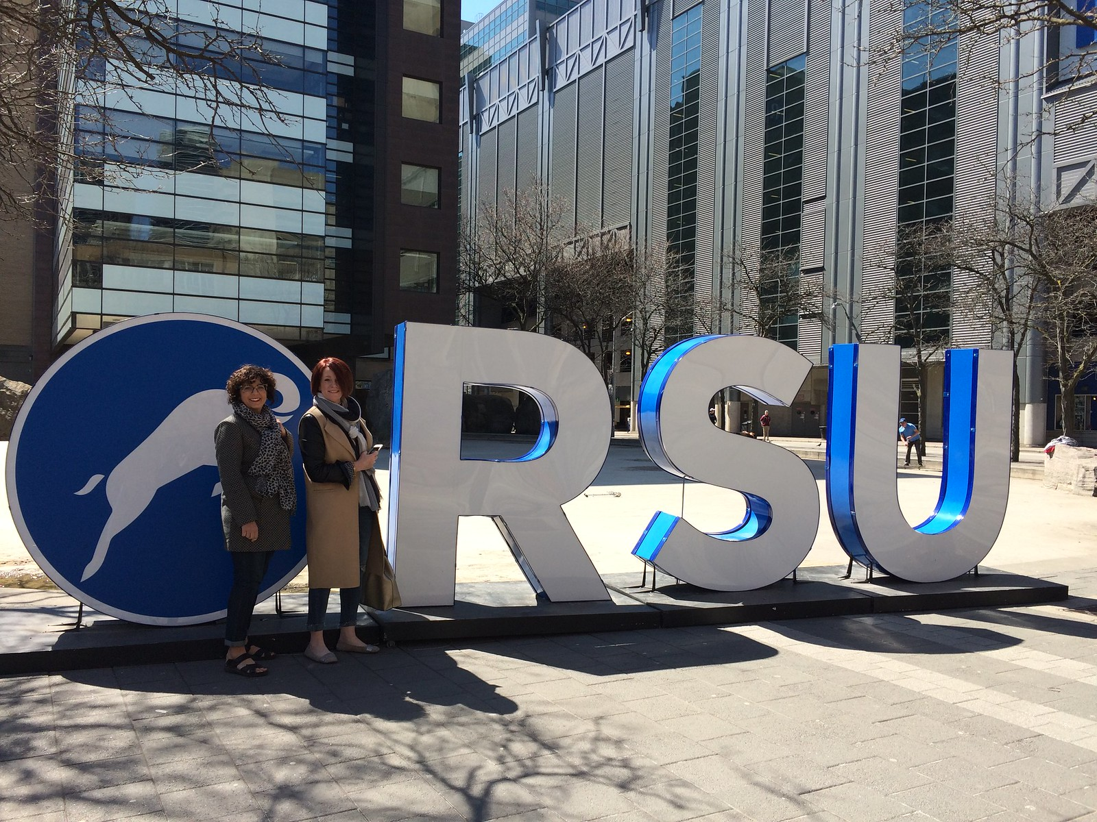 standing in front of the RSU sign on campus