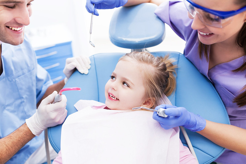 a kid getting her teeth whitened