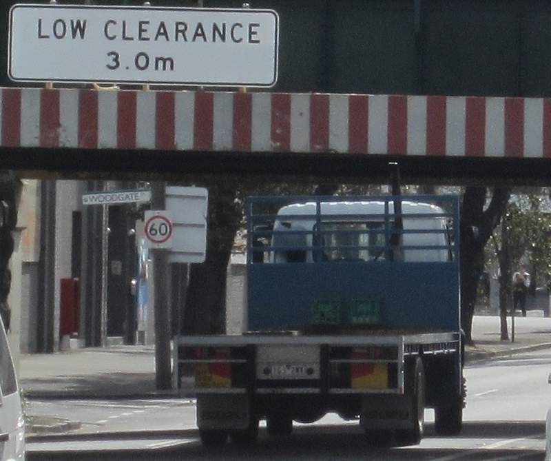 Truck damages exhaust, Montague St bridge