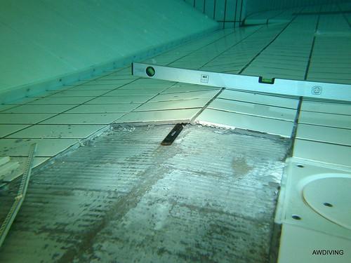 Tegel schade zwembad