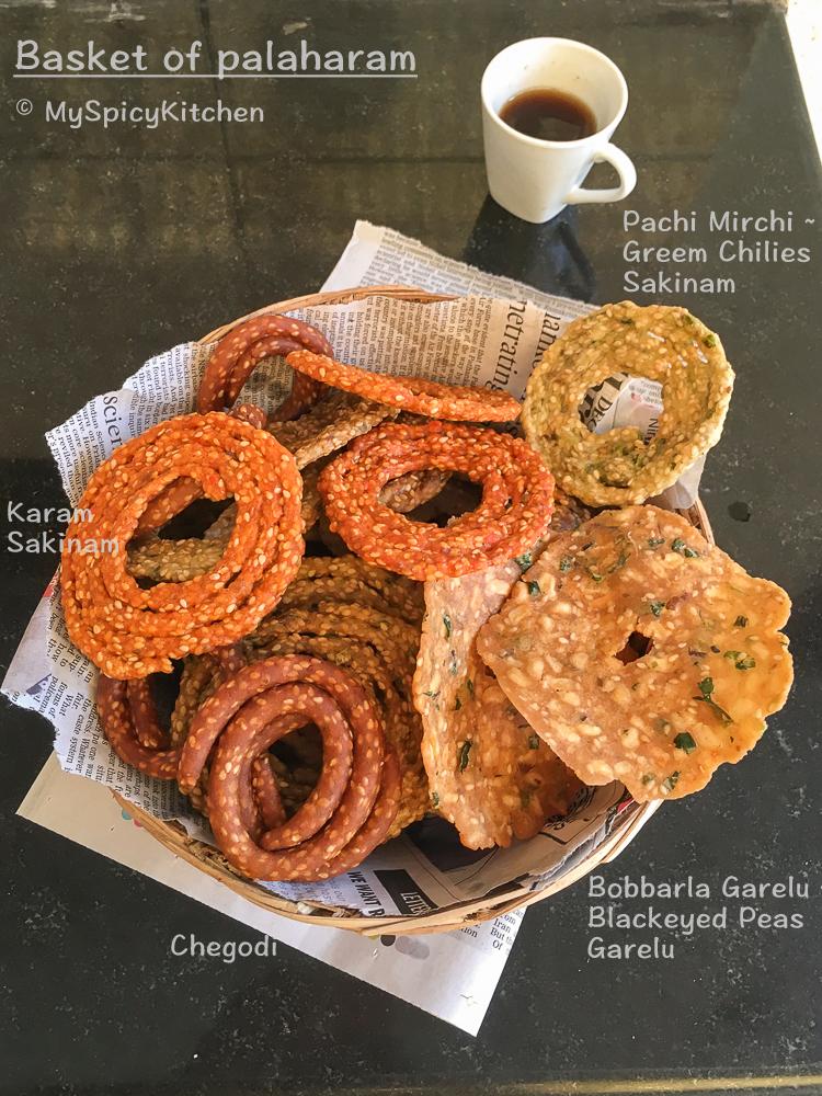 Basket of Palaharam which has karam sakinalu tella sakinalu chegodi and garelu.