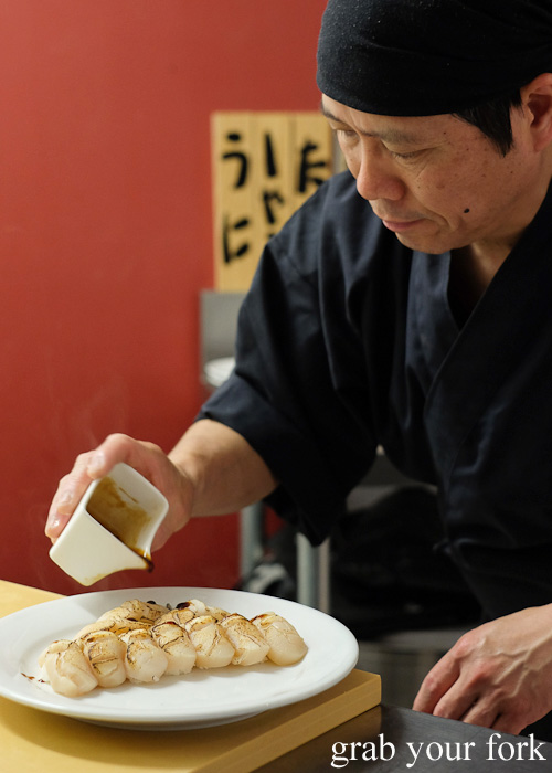 Adding sweet soy to blowtorched scallops at Sashimi Shinsengumi, Crows Nest