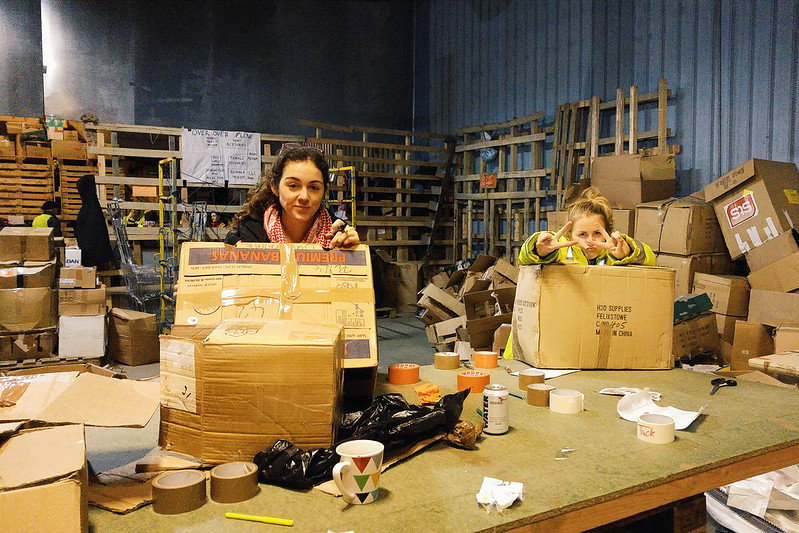 Volunteers with boxes in the Calais warehouse