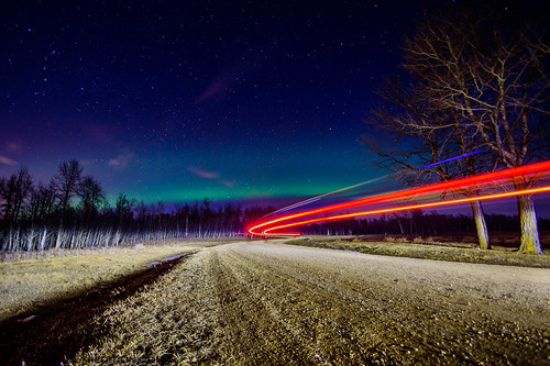 car trails and aurora
