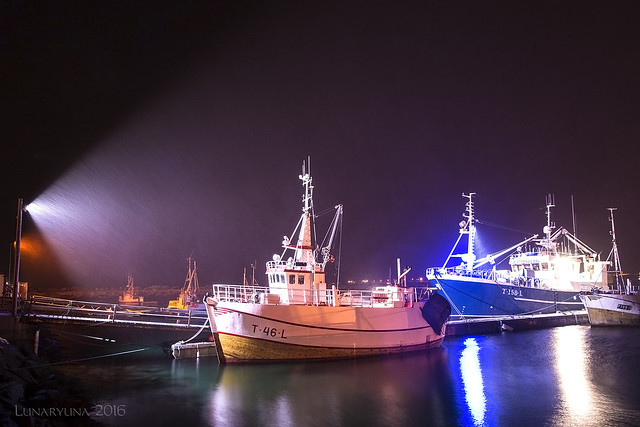 Norwegian fisherboats facing a blizzard in the night
