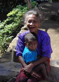 Bajawa in West Timor on the Island of Flores Indonesia. Old lady and child.