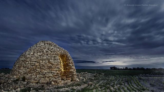 Old dry stone hut in a cloudy night (Jorquera, Albacete, Spain)