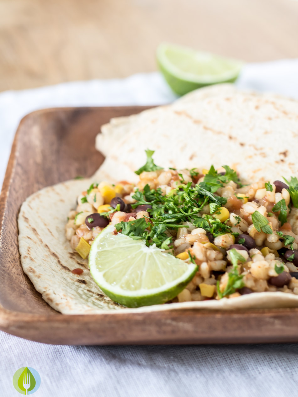 barley, sweet corn and blackbean burritos in a soft tortilla with lime