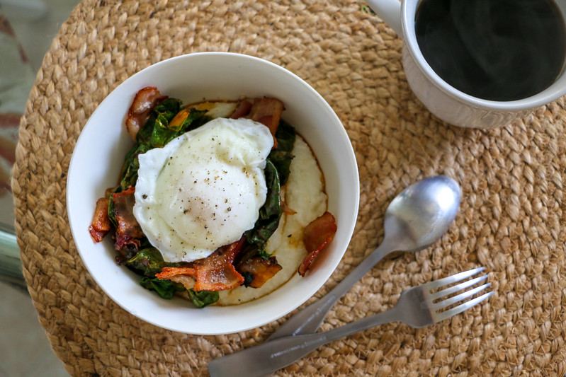 03.20. Cheesy Grits with poached eggs, greens and bacon