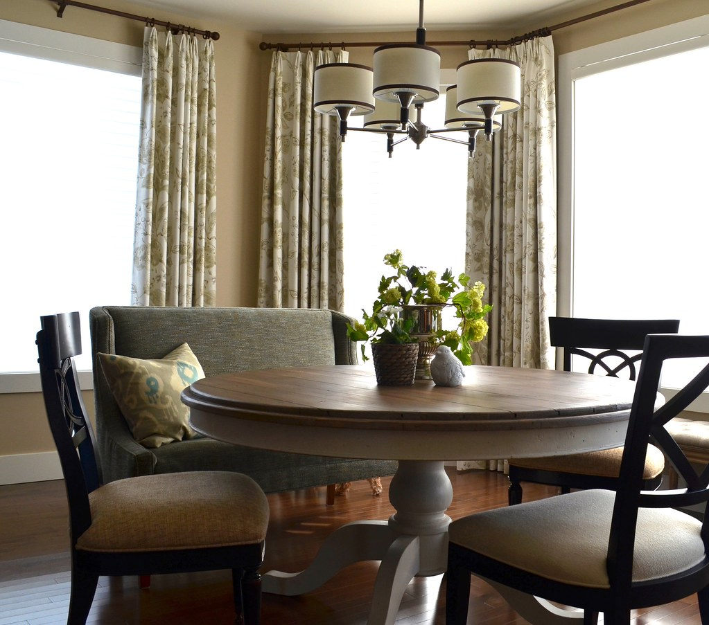 elegant dining nook with custom bench and custom draperies