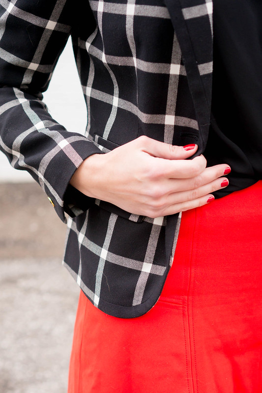 black and white plaid blazer + black wrap blouse + red skirt + black quilted purse; spring work outfit | Style On Target