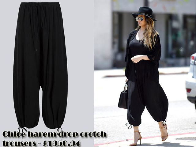 Chloe-harem-drop-crotch-trousers-fedora-hat,Parachute pants, Parachute trousers, harem drop crotch trousers, harem drop crotch pants,  wide brimmed hat,  aviator sunglasses, billowing black trousers, black top, oversized cardigan, tan stilettos, black leather bag with a rounded brown handle