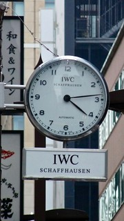 Probus Scafusia. IWC Clock sign 時計of a luxury watch and jewellery store in Ginza 銀座 Tokyo, Japan