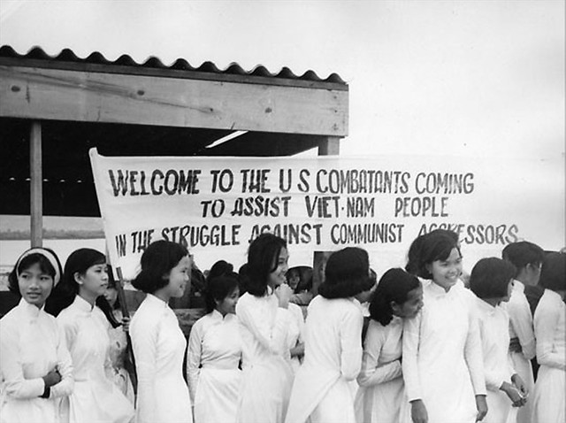 Young Vietnamese girls on hand to greet American troops 1966