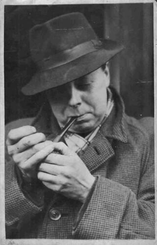 Paul Graney lighting his pipe