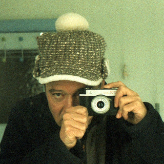 reflected self-portrait with Smena 8M camera and bobbled trapper hat
