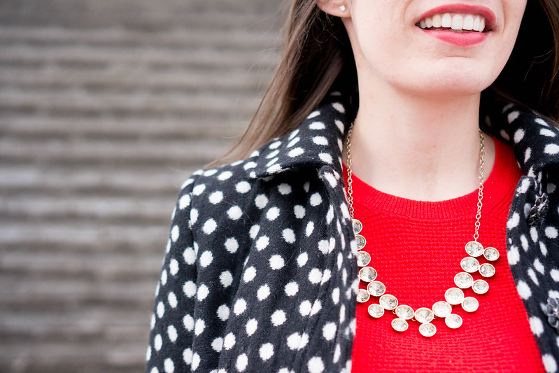 polka dot coat + red sweater + quilted black crossbody purse | Style On Target