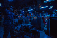 Capt. Adam Aycock, commanding officer of USS Shiloh (CG 67), explains the ship's ballistic missile defense capabilities during the exercise. (U.S. Navy/MC3 Sara B. Sexton)