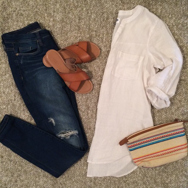 white tunic + distressed skinny jeans + leather crossover sandals + boho clutch