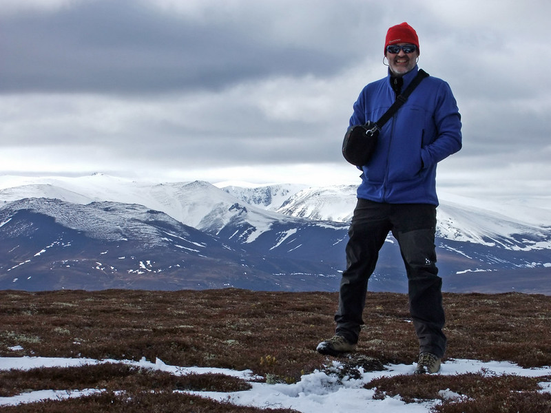 Summit photo (time delay) with Ben Avon and Beinn A' Bhuird beyond
