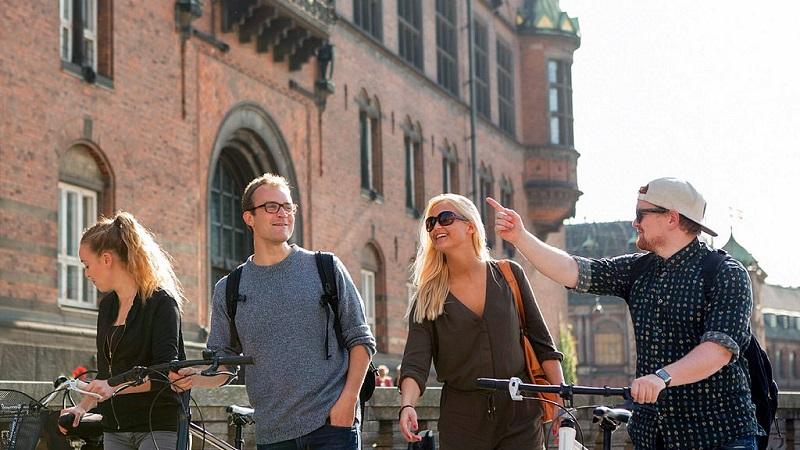 Four students walking through a European city