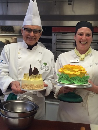 Provost Dave Witty and Student proudly displaying cake decorating skills.