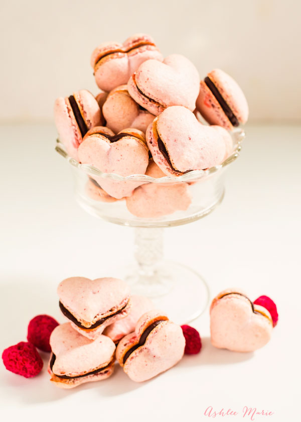pink raspberry heart macarons filled with chocolate are sweet, crunchy and perfect to make for those you love