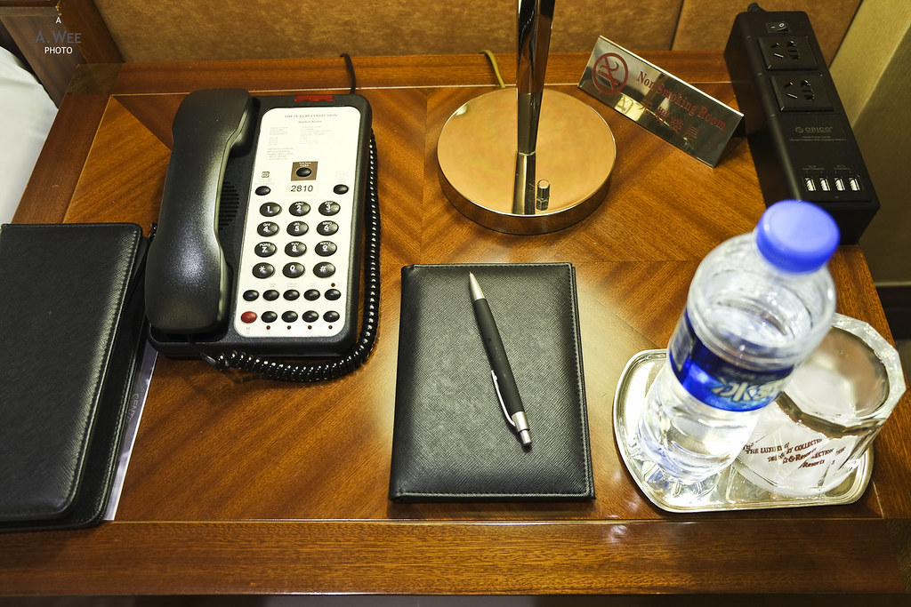 Bedside table with amenities