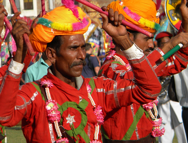 Male dancers with red whirling skirts and bells on their ankles at the Jaipur Elephant Festival