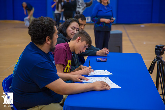 Two Seniors Sign to Play College Sports