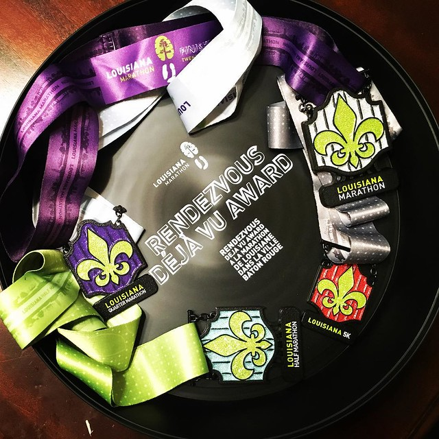 Happy #medalmonday. Showing off the bling @fueledxrunning and I got at @thelamarathon! And we got the tray for running both days. Fun times, great people and an awesome party! #geauxrunla #runlouisiana #running #runforbling #bling #runchat #runhappy #inst