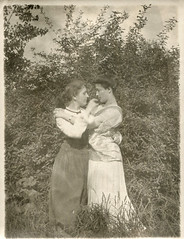 Two affectionate women embracing in a field