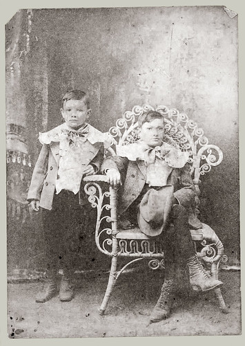 Two children and a wicker chair