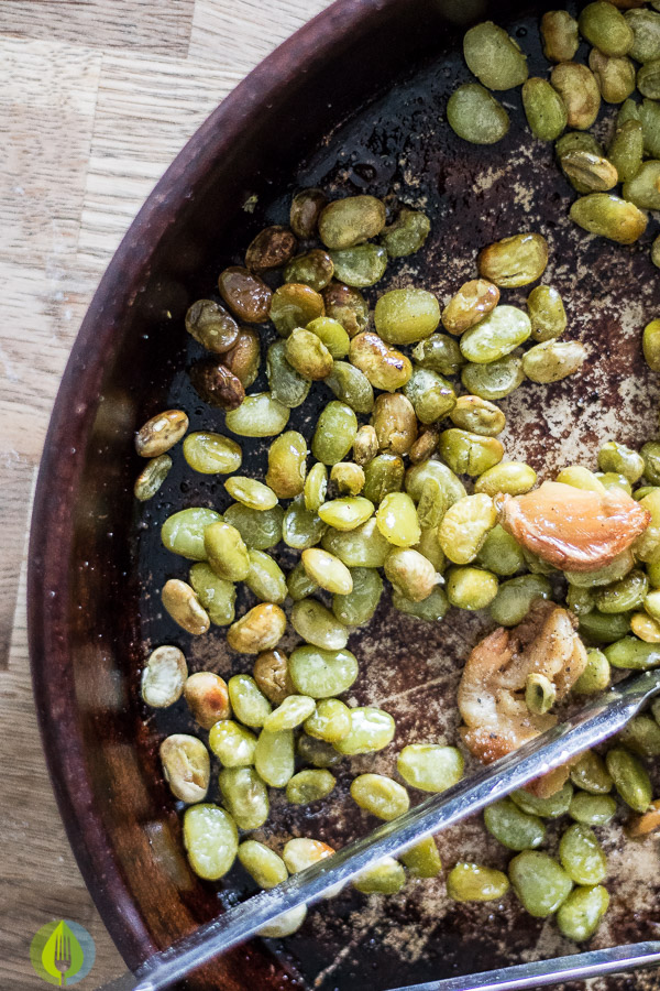 Oven Roasted Lima Beans and Garlic in terracotta baking dish