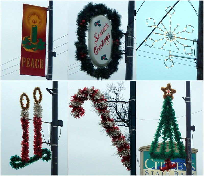 Peace banner, Season's Greetings oval, white wire snowflake, tinsel candles, candy cane, and tree