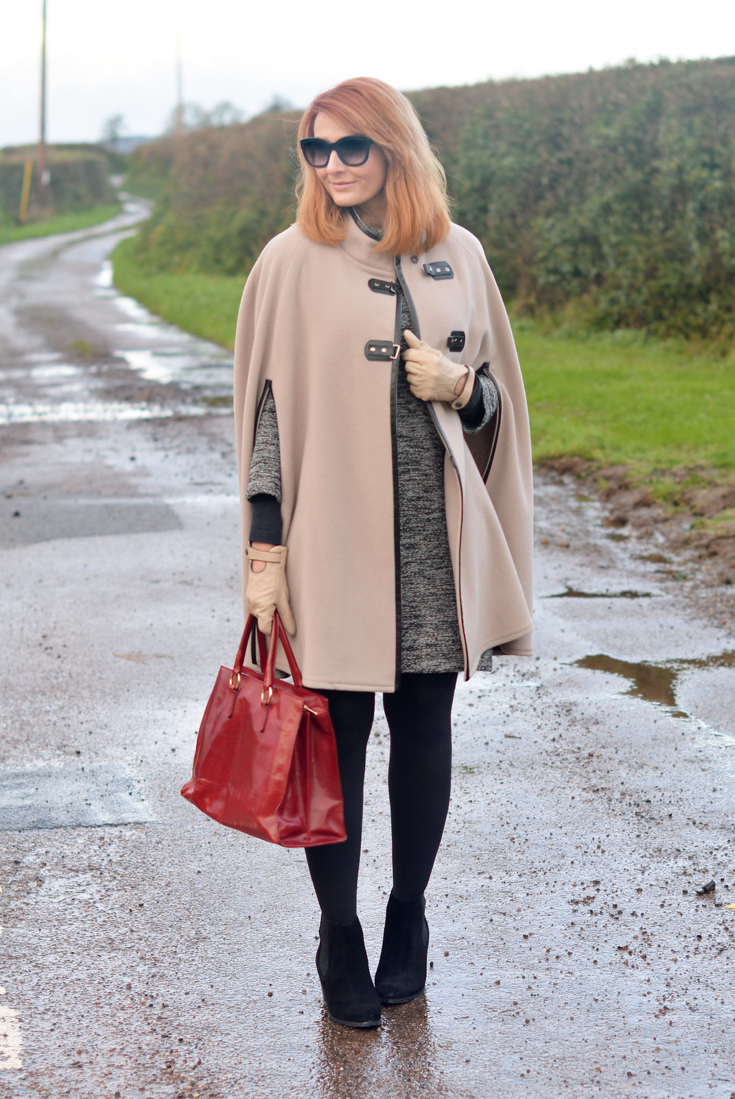 Winter Style   Camel cape, sweater dress, red tote, black tights