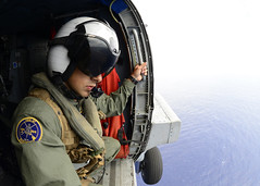 In this file photo, a naval air crewman watches out the door of an MH-60R Seahawk helicopter attached to Helicopter Maritime Strike Squadron (HSM) 37 as they conducted flight training operations over the island of Molokai, Hawaii, March 8.  (U.S. Navy/MCC John M. Hageman)