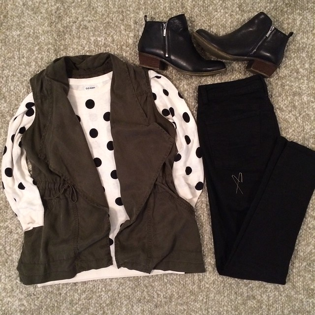 olive vest + polka dot sweater + black skinny jeans + black booties
