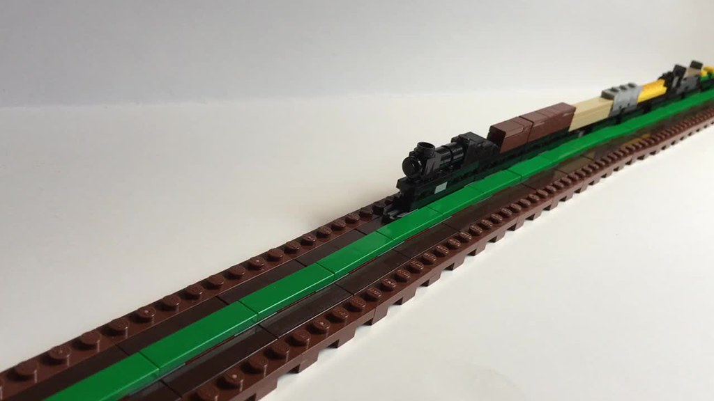 One stud wide trains built using LEGO(R) elements. Gliding, pushing, moving, switching.