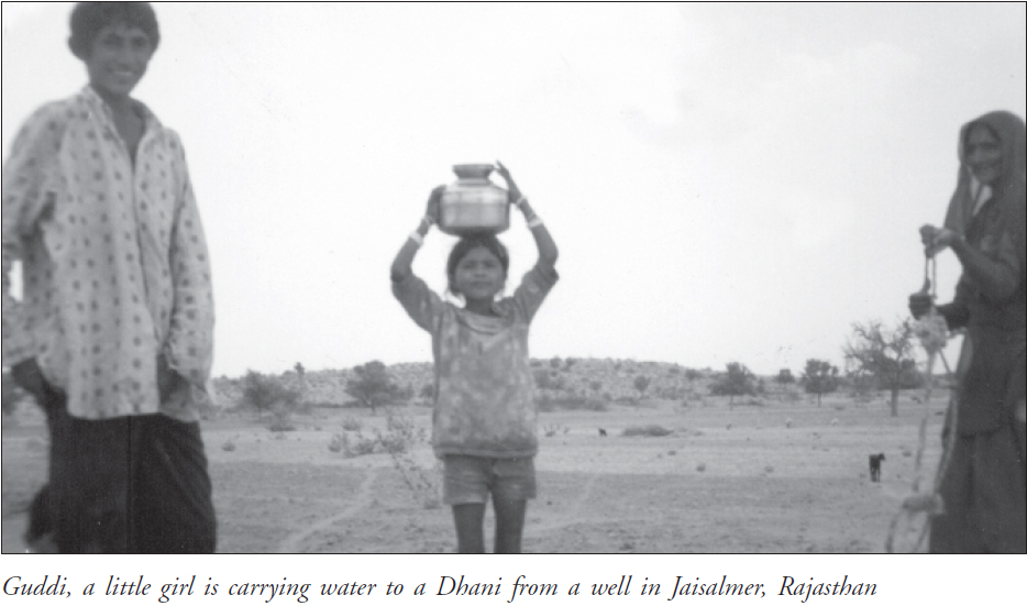 Guddi, a little girl is carrying water to a Dhani from a well in Jaisalmer, Rajasthan