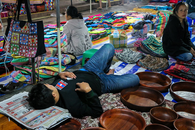 Sleeping man at night market, Luang Prabang, laos ルアンパバーン、夜市で爆睡中の男性