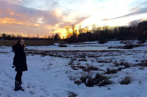 Amy at sunset by a snowy marsh