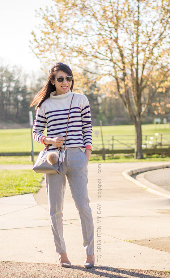 striped sweater, gray pants, colorblocked crossbody bag with fur pom keychain, gray suede pumps