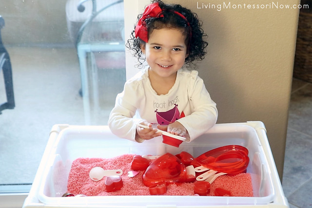 Having Fun with the Valentine's Day Sensory Bin with Practical Life and Math Activities