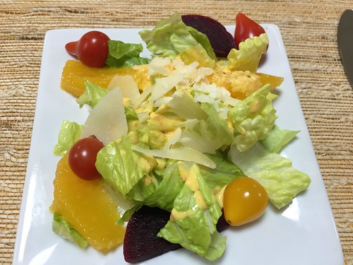 Miso salad: romaine lettuce, Spring salad with miso carrot dressing, orange segments, pear tomatoes, red beets and shaved parmigiano reggiano